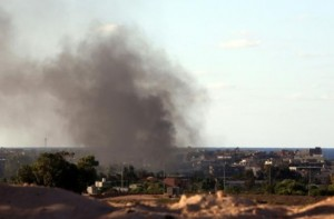 Smoke billows from buildings after the air force from the pro-government forces loyal to Libya's Government of National Unity fired rockets targeting Daesh in Sitre. (AFP/File)