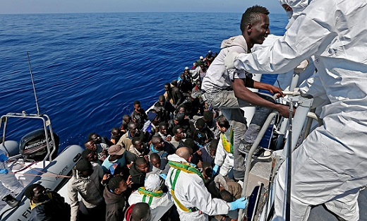 Migrants being rescued by an Italian ship