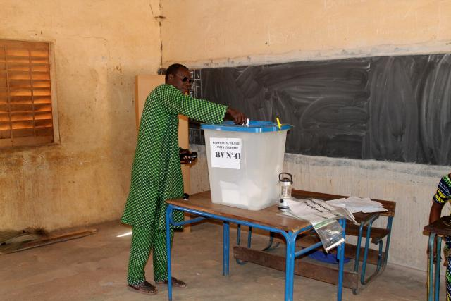 A man votes in local elections in Bamako
