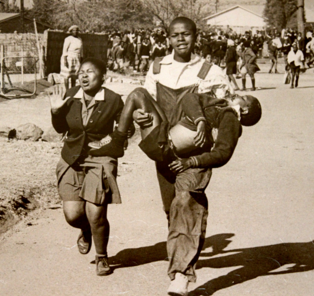 A picture of a dying 14 year old Hector Pieterson during the Soweto student riots. (June 16th 1976)