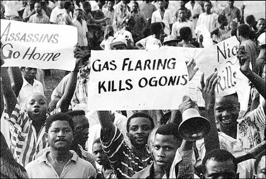 Ogoni people demonstrating against oil companies. Eventually, Shell oil company discontinued it's million-dollar operation in Ogoni land.