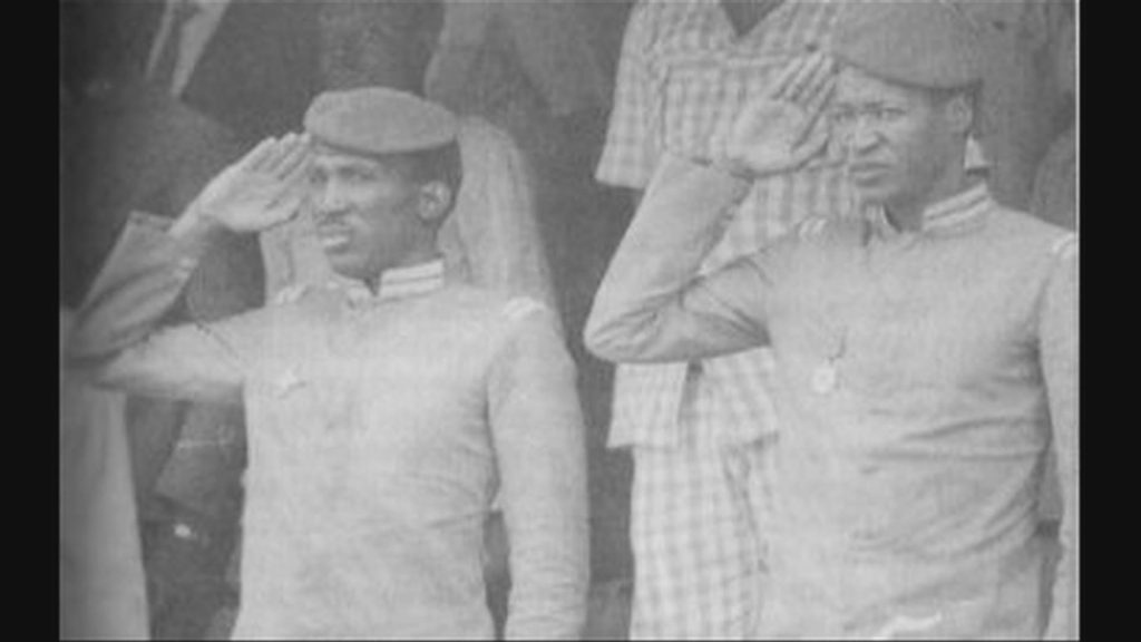 Thomas Sankara (left) with his close friend Blaise Compaore. Compaore is alleged to have plotted Sankara's assassination.