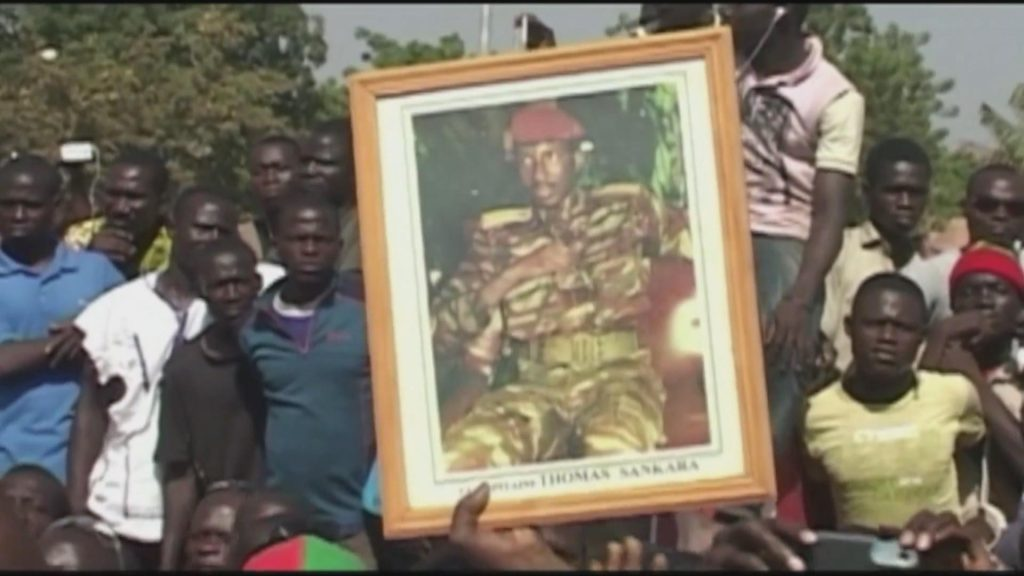 During the 2014 protests, young people carrying Sankara's photo. Sankara's ideas and principles were awakened and chanted by the young people of Burkina Faso.