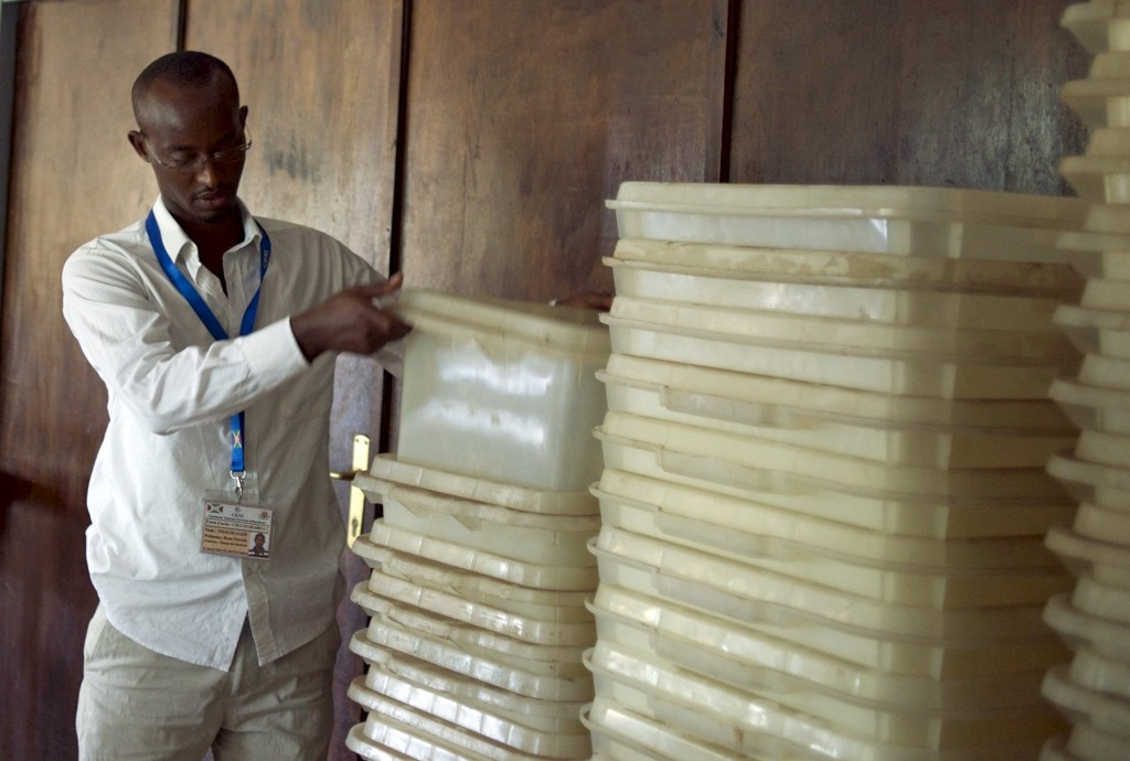 Member of Burundi's National Electoral Commission counts ballot boxes at a warehouse used to store electoral material for the upcoming parliamentary elections, in the neighbourhood of Nyakabiga near the capital Bujumbura