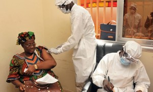 A woman is vaccinated in Conakry, Guinea, during the first clinical trials of the rVSV-ZEBOV vaccine against the Ebola virus. Photograph: Cellou Binani/AFP/Getty Images