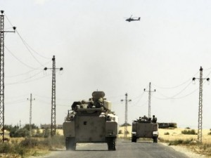 sinai_a_helicopter_flies_overhead_as_soldiers_in_military_vehicles_proceed_towards_al-jura_district_in_el-arish_city_from_sheikh_zuwaid