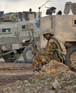 AMISOM/ Ugandan soldiers resting in the town of Kurtunwaarey in the Lower Shabelle region of Somalia .