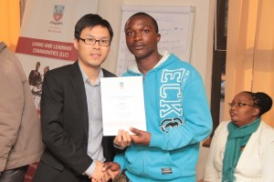 Huawei-PR-Manager-Gives-Training-Certificate-to-UB-Orientator