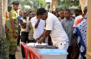 A man casts his ballot at a polling station during the presidential and parliamentary election in Ilala polling station, Dar es Salaam