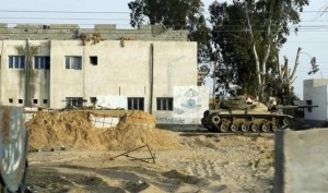 An Egyptian army tank is seen stationed outside a school taken over by soldiers in the Sinai Peninsula