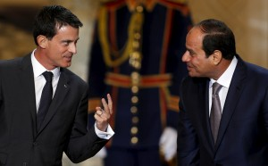 Egypt's President Abdel Fattah al-Sisi speaks with French Prime Minister Manuel Valls during a ceremony to sign military contracts at the Ittihadiya presidential palace in Cairo