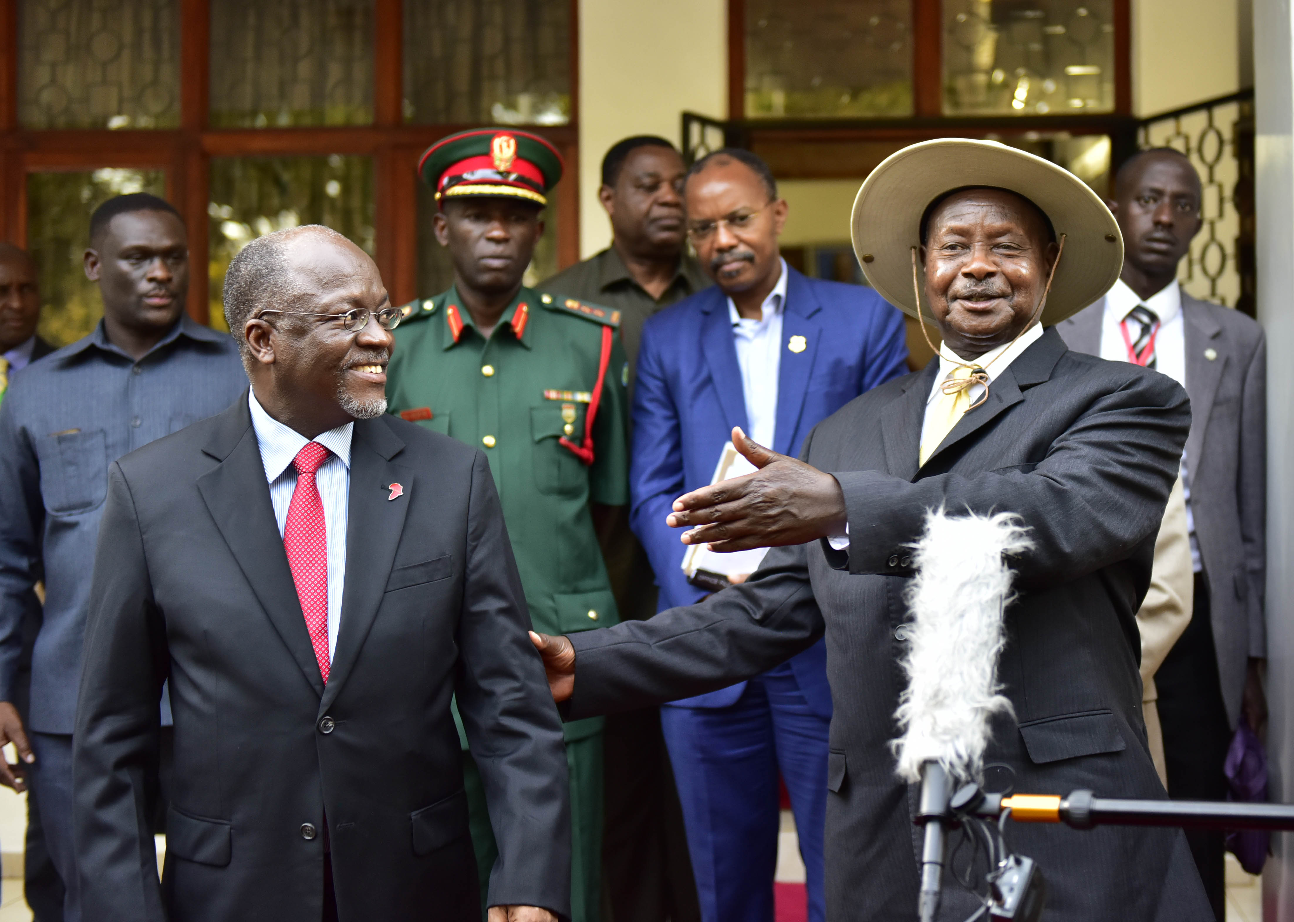 The President Yoweri Kaguta Musevenio interacts with Tanzanian President John Pombe Magufuli shortly after the bilateral meeting at the Arusha state lodge in Tanzania on Tuesday 30th February 2016. President Museveni together with the East African Heads of State are meeting in Arusha for the 17th Ordinary Summit.