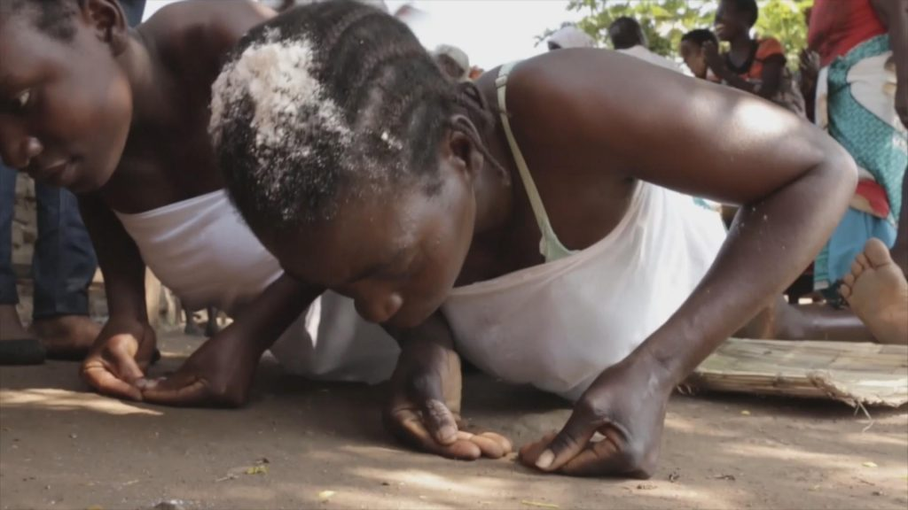 Girls about to undergo a customary sexual initiation. At the onset of puberty, Malawian virgin girls undergo sexual initiation by having sex with a hyena man.