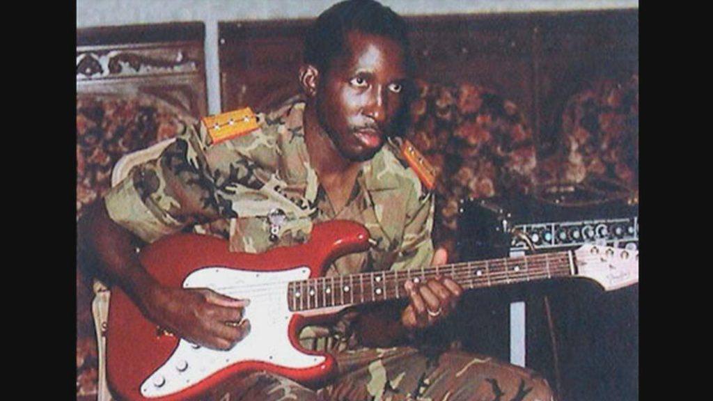Thomas Sankara playing his favorite instrument, a guitar. He was the president of Burkina Faso for four years. He was assassinated on October 15th 1987.