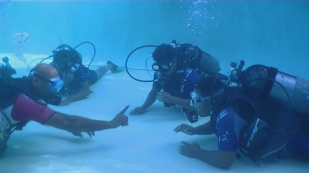 Vikash training on how to dive.