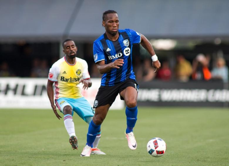 Jun 18, 2016; Columbus, OH, USA;  Montreal Impact forward Didier Drogba (11) dribbles the ball while Columbus Crew SC midfielder Mohammed Saeid (8) defends in the first half of the match at MAPFRE Stadium. Mandatory Credit: Trevor Ruszkowski-USA TODAY Sports  / Reuters  Picture Supplied by Action Images