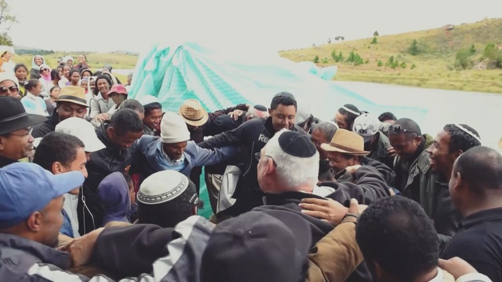 The converts awaiting immersion into the river which serves as a ritual bath in Judaism
