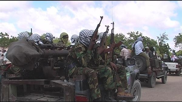 Al-Shabab militants drive through Mogadishu in a show of force. Driving them out of the Somali capital was a painstaking process that took years to complete. They were pushed out of the in August 2011.
