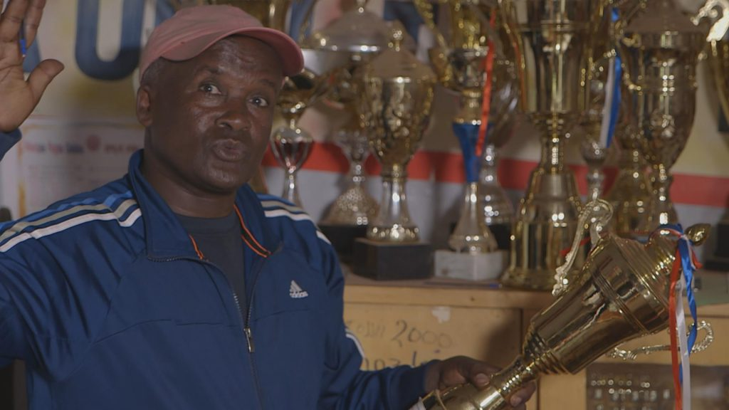Coach Sentayehu Eshetu, showing his medals. He trains and nurtures young running talent in Bekoji, Ethiopia.