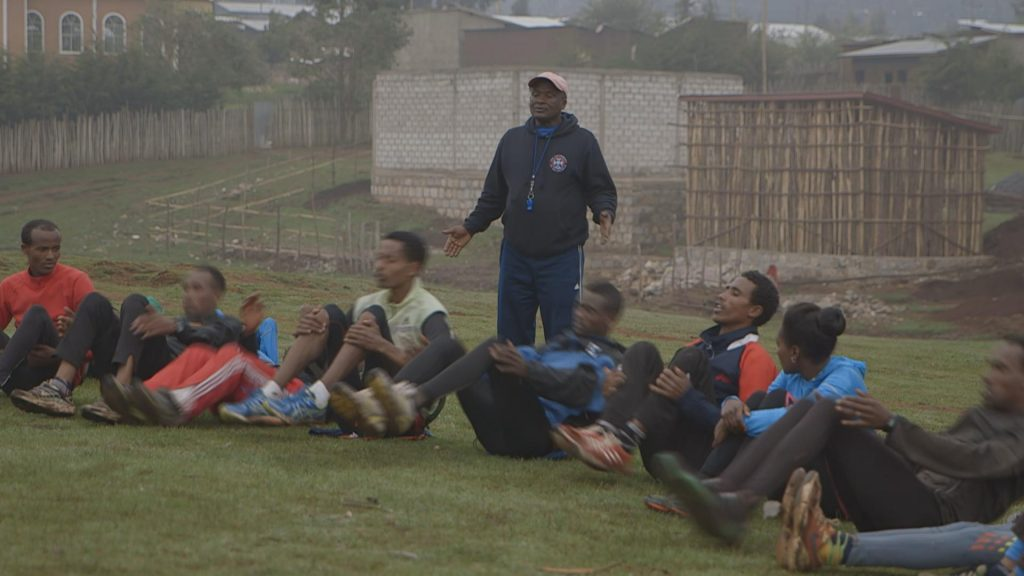 Coach Sentayehu with his students during a training session in Bekoji.