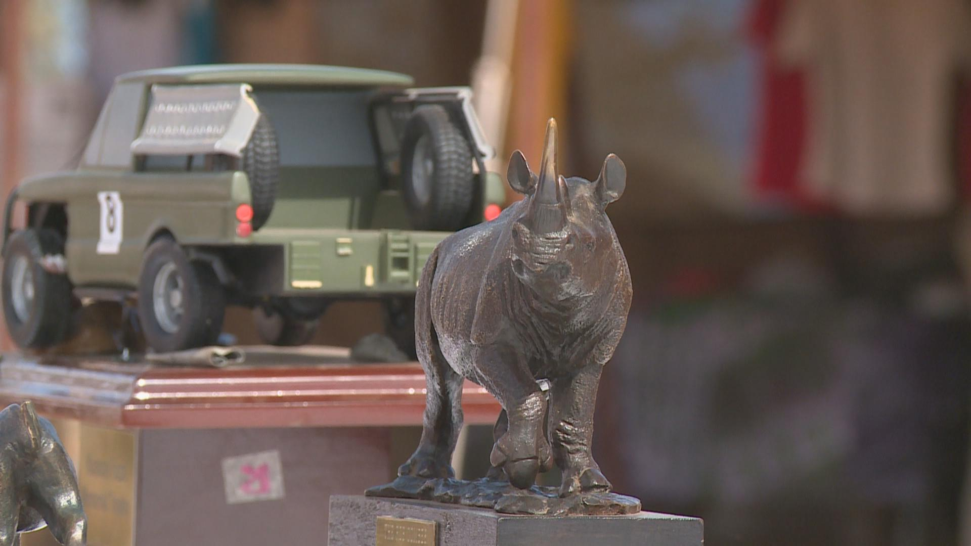 A trophy of a rhino and race car.