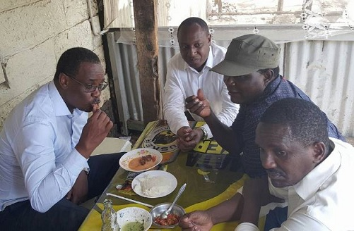 Nairobi Governor Evans Kidero and his deputy Brian Weke have a meal at a local hotel in downtown Nairobi.