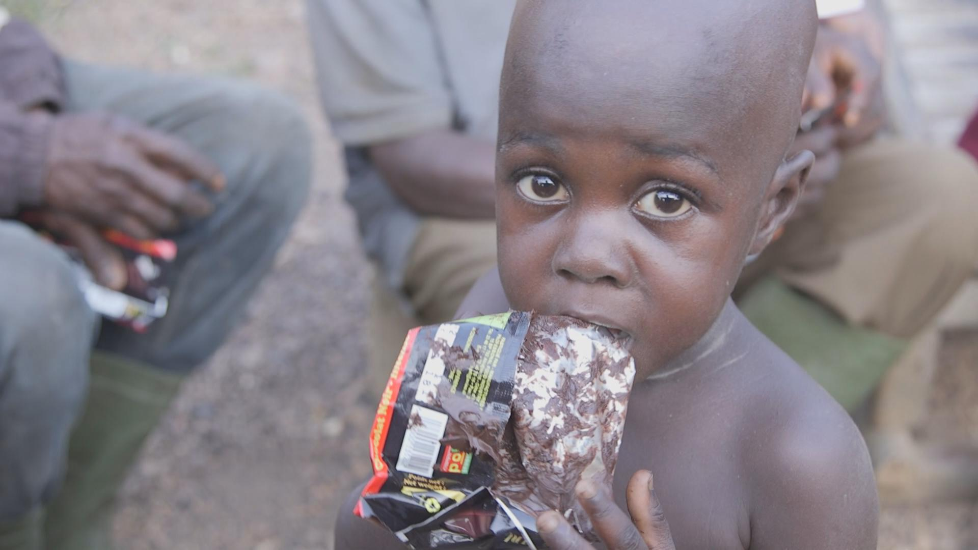 One of the cacao's farmers child enjoying chocolate. Most cacao farmers in Cote d'Ivoire have never tasted chocolate.