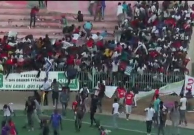 A fight broke out between fans of rivals U.S. Ouakam and Stade de Mbour and police fired tear gas to break it up. Image courtesy: Malay Mail Online
