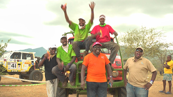 John Kanyali's team celebrates after finishing the 13 checkpoints within the 10 hour deadline