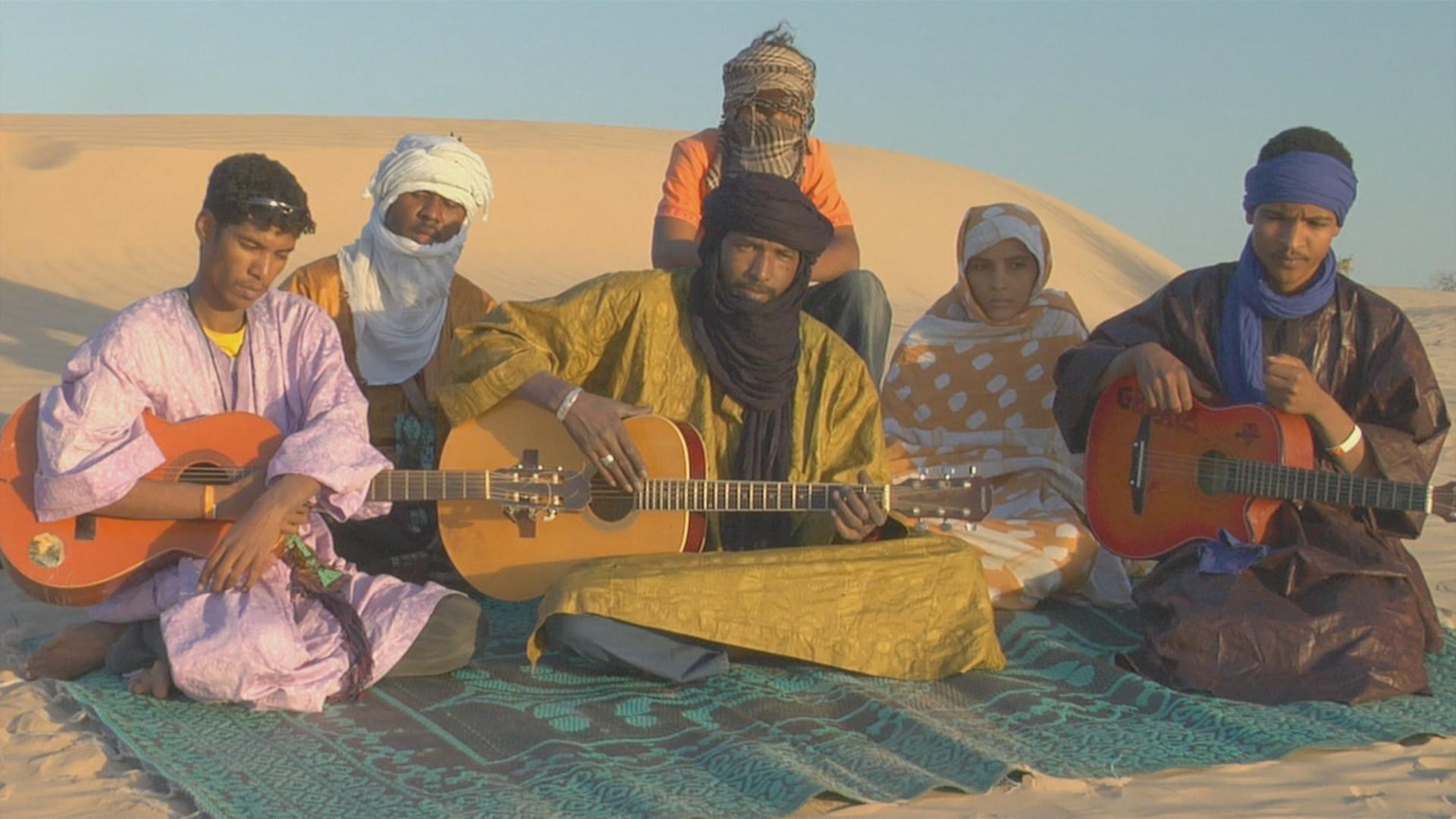 Ahmed's band, Amanar. He formed the band upon his return to Mali from Libya.