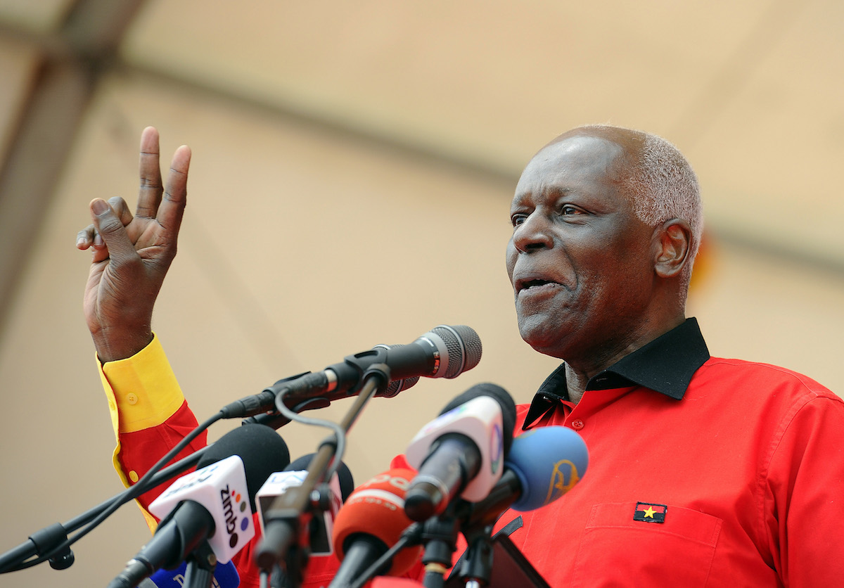 Angolan President Jose Eduardo dos Santos Angolan delivers a speech during his final election campaign rally in Kilamba Kaixi, on the outskirts of Luanda, on August 29, 2012. The ruling popular Movement for the Liberation of Angola (MPLA), which has been in power since independence 37 years ago, will compete on August 31, 2012 in the legislative poll against 8 other political parties, including the main opposition Union for the Total Independence of Angola (UNITA). Dos Santos told the crowd that with a new term he would push ahead with his multi-billion-dollar drive to rebuild the country after the civil war that ended a decade ago. AFP PHOTO / STEPHANE DE SAKUTIN        (Photo credit should read STEPHANE DE SAKUTIN/AFP/GettyImages)
