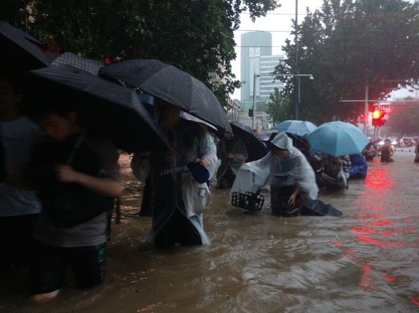 Central China's Henan province swamped after heaviest rain in 1,000 years
